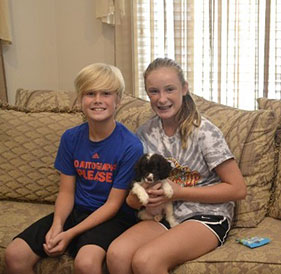 Blonde Siblings with Small Puppy