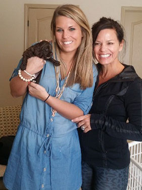 Two Women with Small Puppy