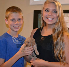 siblings with Small Tan Puppy